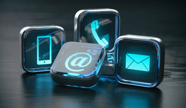 Signs of phone, mobile, letter and e-mail on blue neon blocks