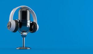 Radio microphone with headphones on blue background