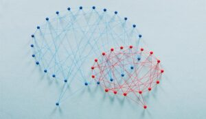Red and blue speech bubbles made out of pins and string