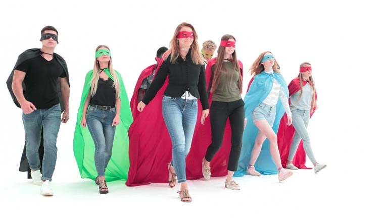 confident team of superheroes striding towards their goal