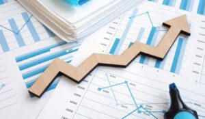 Financial report with graphs and arrow.