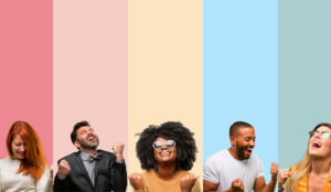 Group of people on coloured backgrounds celebrating