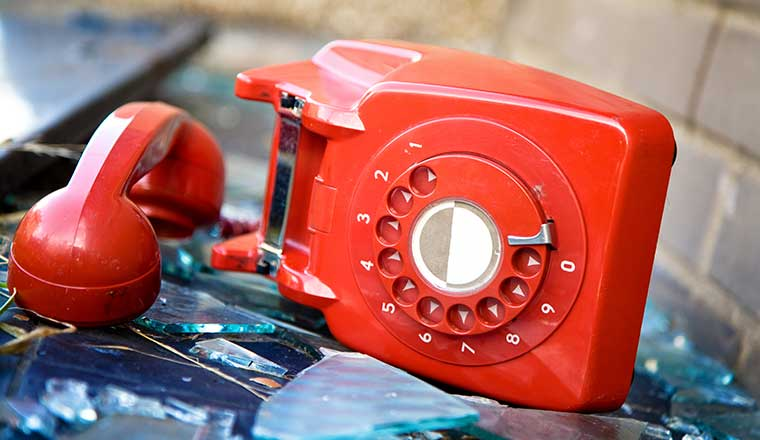A red phone that has been abandoned