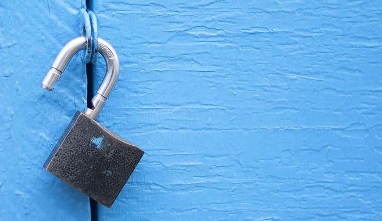 Open lock on blue door background