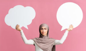 Person holding two empty speech bubbles
