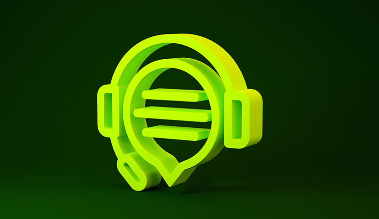 Yellow Headphones with speech bubble chat icon isolated on green background