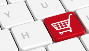 Red key button with a shopping cart on a computer keyboard