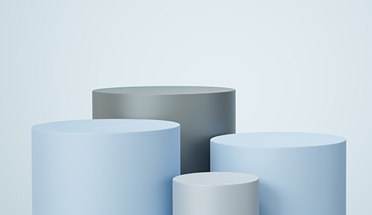Four different sized cylinders on a light blue background