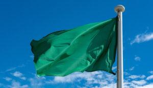 green flag under the sky