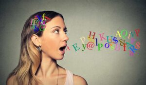 person talking alphabet letters in her head coming out of open mouth