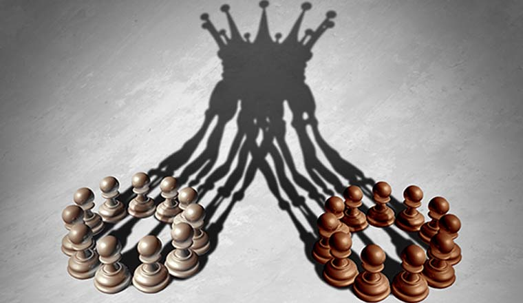Two groups of pawns whose shadows are merging together into a crown