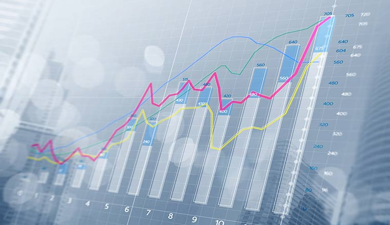 A bar chart and growing graphs with depth of field on bright tone background