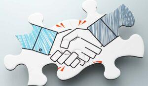 Handshake jigsaw puzzle pieces