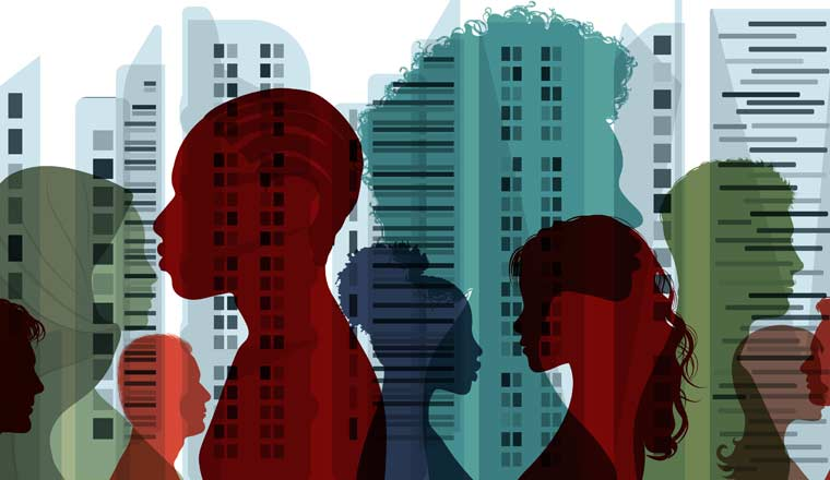 Silhouettes of people in front of office buildings