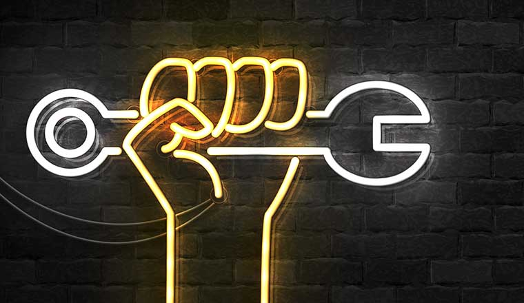 A picture of a neon hand holding a tool