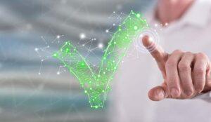 Hand touching a green network tick