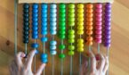 Hands Counting On Colorful Bead Abacus