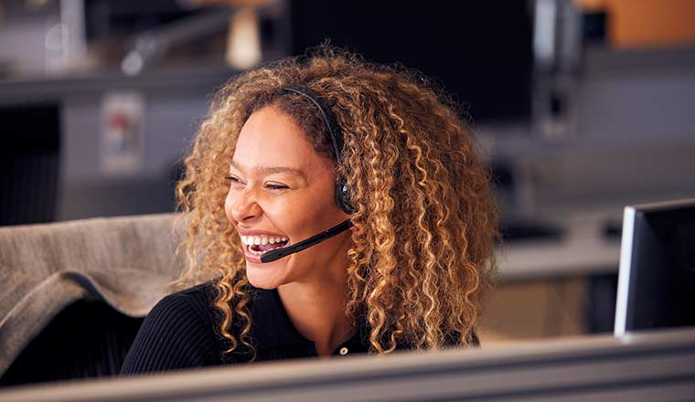 Person in headset laughing