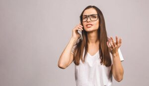Frustrated person talking on phone