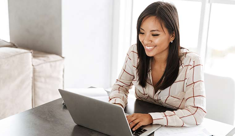 Happy person working at laptop