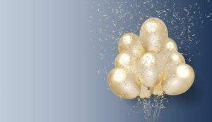 Gold balloons and confetti on blue background
