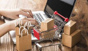 Cartons in a shopping cart on a laptop keyboard