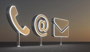 Phone, email and online contact icons in 3D in front of sunset