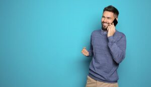 Person on phone isolated on blue background