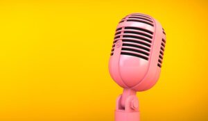pink microphone on yellow background