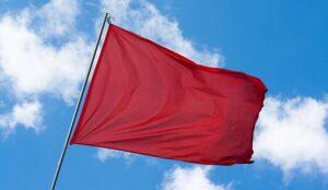 A reg flag on a blue sky background