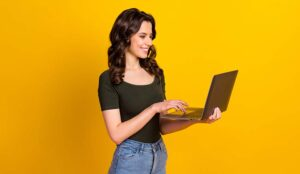 Person holding in hand laptop working isolated on bright background
