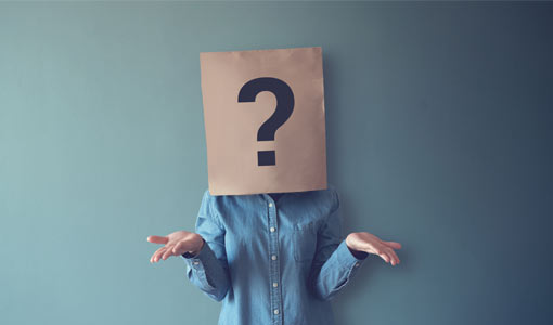A picture of a person with a brown paper bag with a question mark