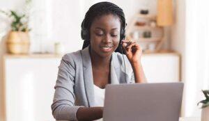 Person wearing headset sat at laptop