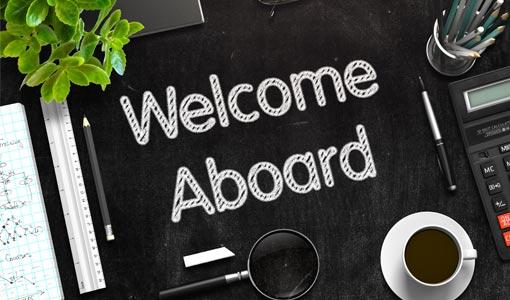 Welcome Aboard - Text on Black Chalkboard