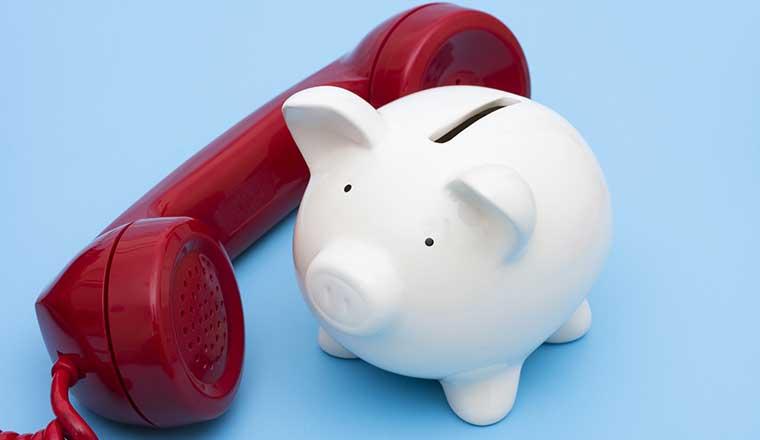 A piggy bank and a phone