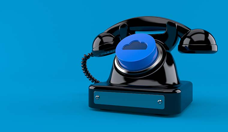 Old telephone with cloud button on blue background