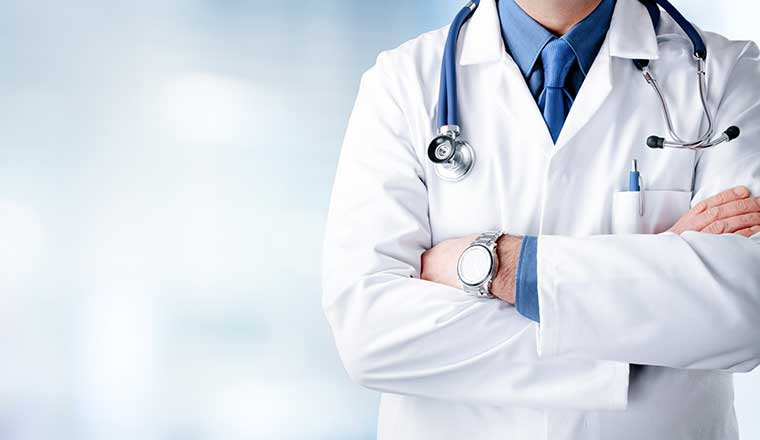 A doctor with stethoscope and lab coat