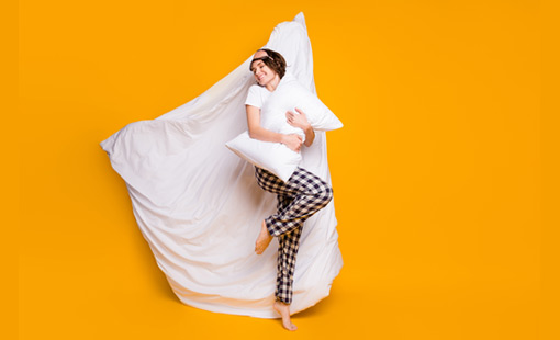 A picture of person lying on a duvet