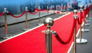 A red carpet and barrier on entrance