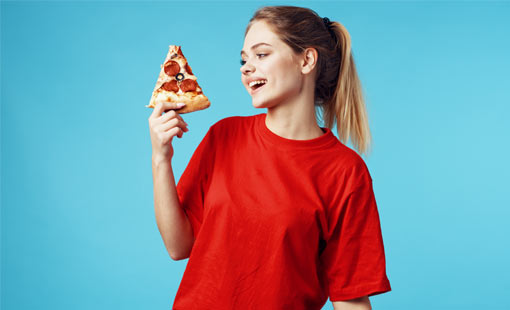 A picture of a girl holding a slice of Pizza