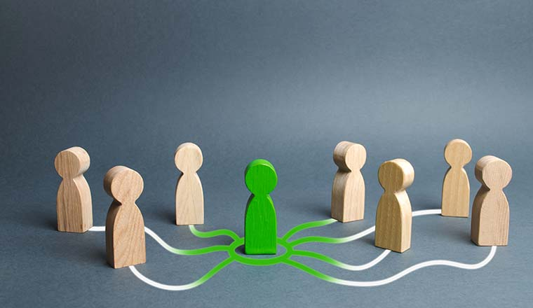 The green figure of a person unites other people around him.