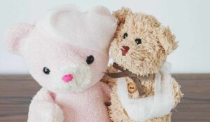 Teddy bear and friend with bandaged head and arm