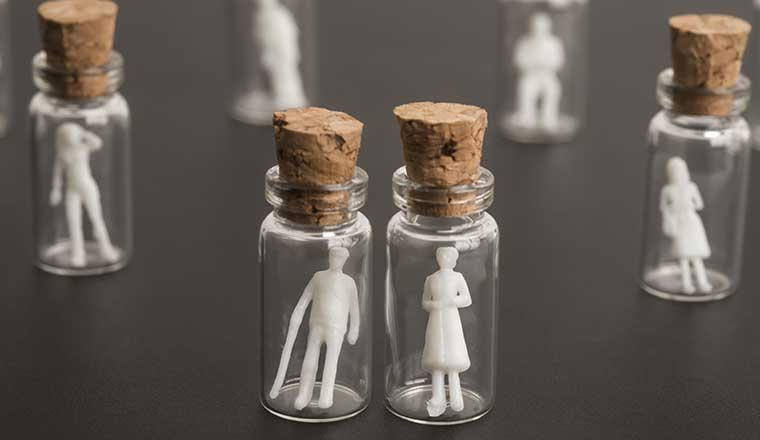 An image of small plastic people in jars