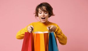 Happy person looking into shopping bags
