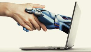 The handshake human with artificial intelligence via laptop