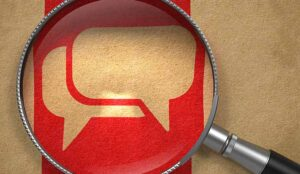 Magnifying Glass with Speech Bubble Icon