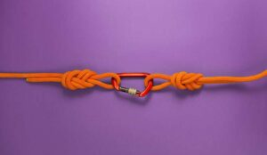 Two ropes linked together representing acquisition and merging