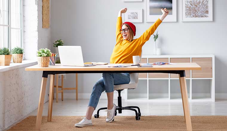 Person working from home celebrating